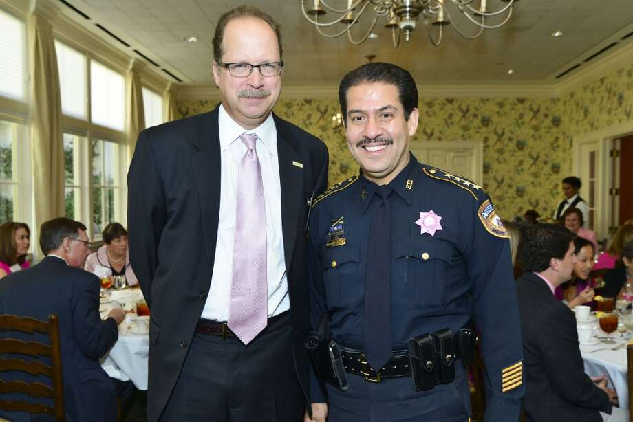 American Cancer Society's Tickled Pink Luncheon at the Junior League of Houston. Ted Yank and Sheriff Adrian Garcia. Photo: CatchLight Group