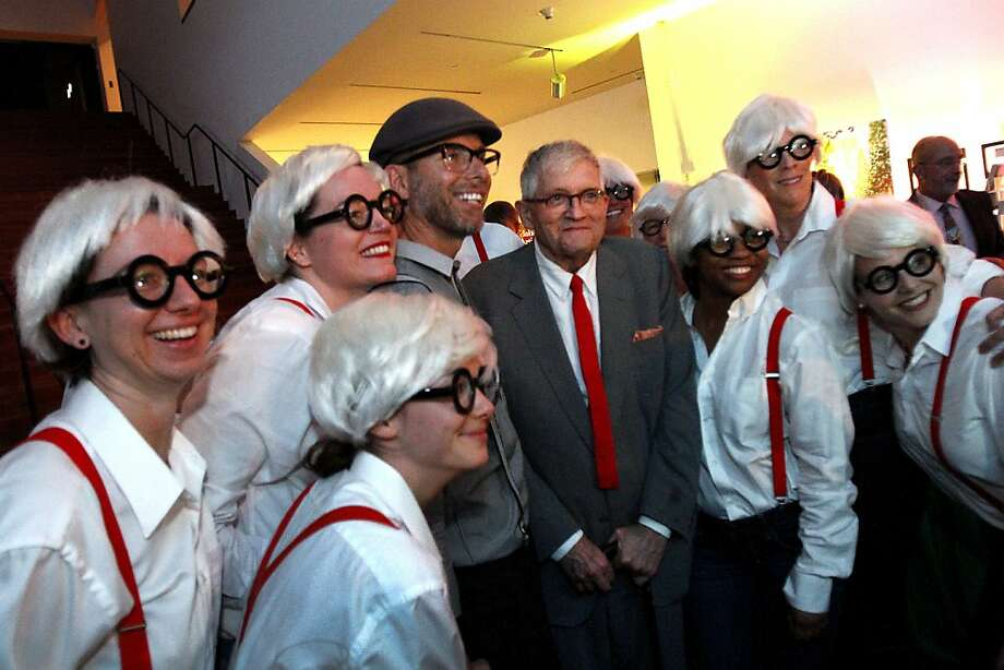 The artist David Hockney poses for a photograph with a group dressed like him at the de Young Museum in San Francisco, Calif., on Thursday, October 24, 2013.  His retrospective opens at the museum on Saturday. Photo: Sarah Rice, Special To The Chronicle