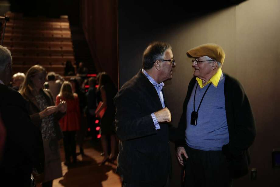 David Hockney (right) greets Peter Goulds (left), who  says he has been David's dealer in the United States since 1979 and owner of LA Louver Gallery,  after Hockney spoke at  a press preview at the de Young museum on Thursday, October 24, 2013 in San Francisco, Calif. Photo: Lea Suzuki, The Chronicle