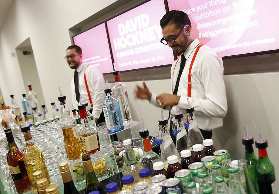 Even the bartenders dressed to honor artist David Hockney at the de Young Museum in San Francisco, Calif., on Thursday, October 24, 2013.  At right is Sean Miller and at left is Josh Liem. Photo: Sarah Rice, Special To The Chronicle