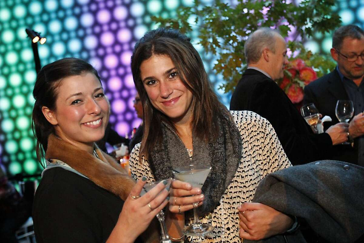 Zoe Feld, left, and Zina Jaffe, both of San Francisco, attend a gala to honor artist David Hockney at the de Young Museum in San Francisco, Calif., on Thursday, October 24, 2013. His retrospective opens at the museum on Saturday.