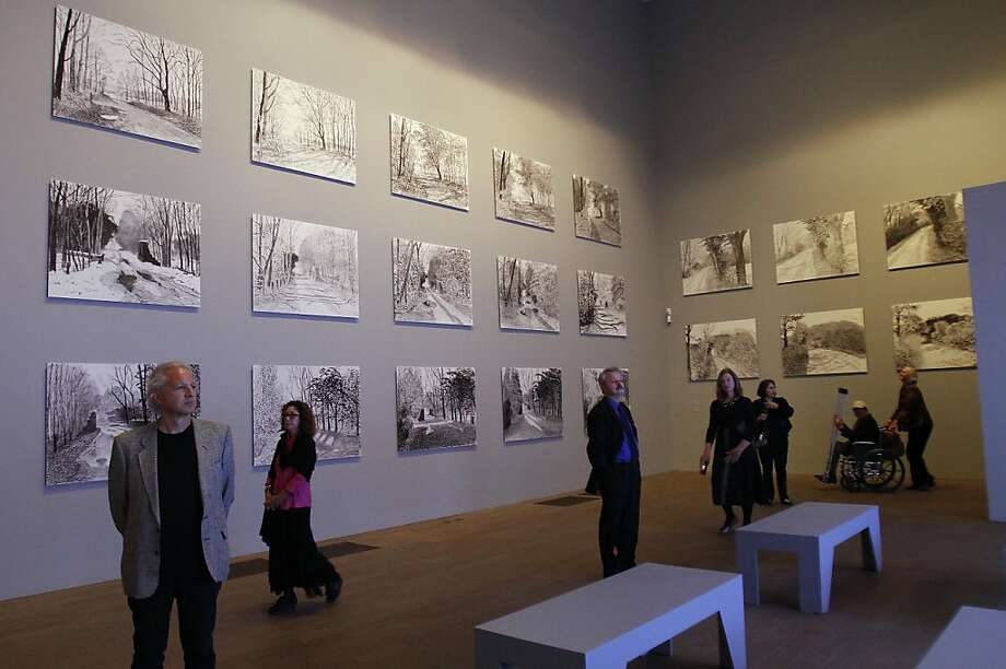 Gala attendees take in work by artist David Hockney at the de Young Museum in San Francisco, Calif., on Thursday, October 24, 2013.  His retrospective opens at the museum on Saturday. Photo: Sarah Rice, Special To The Chronicle