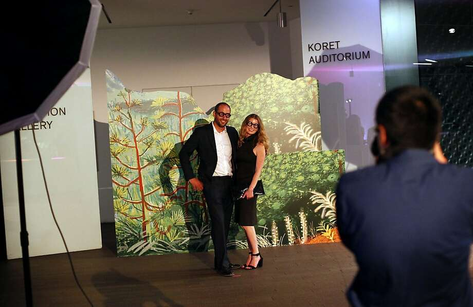 John Bucklin and Kathryn Haskell, both of San Francisco, have their photo taken wearing Hockney glasses at a gala to honor artist David Hockney at the de Young Museum in San Francisco, Calif., on Thursday, October 24, 2013.  His retrospective opens at the museum on Saturday. Photo: Sarah Rice, Special To The Chronicle
