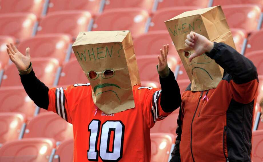 Two Cleveland Browns fans react after the Browns lost to the St. Louis Rams 13-12 in an NFL football game on Sunday, Nov. 13, 2011, in Cleveland. (AP Photo/Tony Dejak) Photo: Tony Dejak, STF / AP
