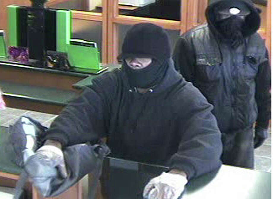 Two masked men, one of them armed, are shown during robbery of the TD Bank branch on the Post Road Friday morning. Photo: Fairfield Police Department / Fairfield Citizen contributed
