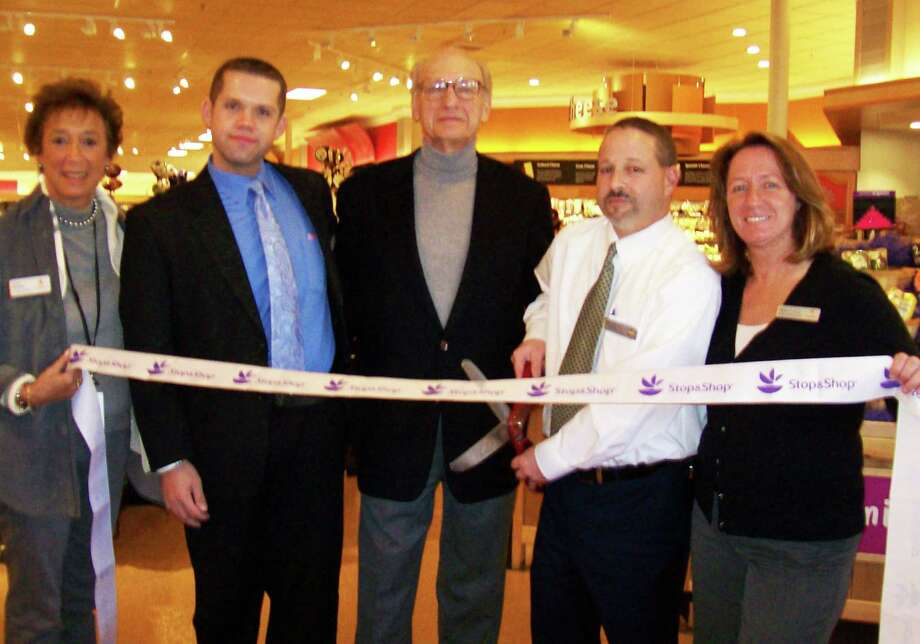 A ribbon-cutting marked the grand reopening of the Super Stop & Shop Friday. Helping kick off the event were (from left) Arlene Putterman, manager, public relations for company's New York Metro Division; Christopher Rider, sales and marketing specialist; Les Byelas, the store's landlord; Mark Gerson, store manager; and Vera Kovalski, director of customer services. Photo: Anne M. Amato / Westport News