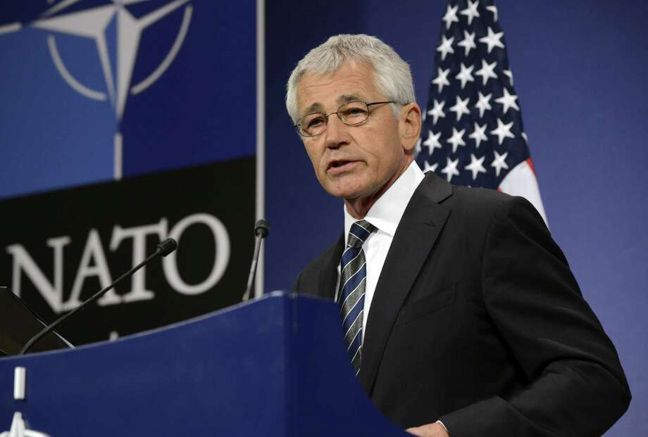 Secretary of Defense Chuck Hagel talks to the media at the NATO headquarters in Brussels. Despite predictions or the organization's demise, NATO still serves a vital purpose. Photo: Thierry Charlier, AFP/Getty Images / AFP