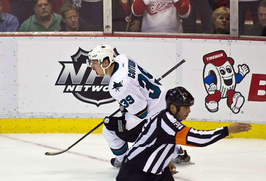 San Jose Sharks forward Logan Couture (39) celebrates his shootout goal after overtime in an NHL hockey game in Detroit, Mich., Monday, Oct. 21, 2013. San Jose won 1-0 on shootouts. (AP Photo/Tony Ding) Photo: Tony Ding, Associated Press