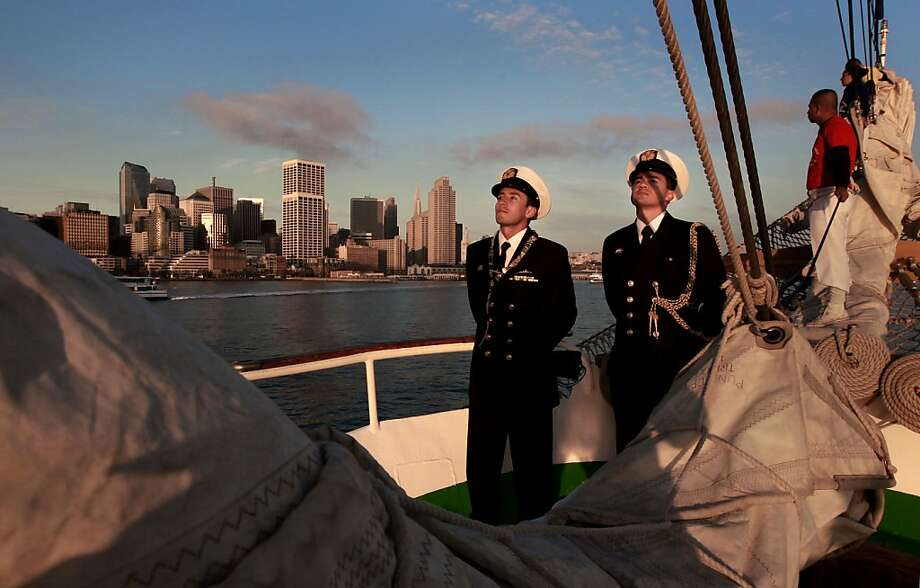 "Crew members aboard the ""Gloria"" a Colombian navy sailing ship on Friday Oct. 25, 2013, as it passes the city skyline while making it's way to pier 17 along the Embarcadero in San Francisco, Calif. Photo: Michael Macor, The Chronicle"