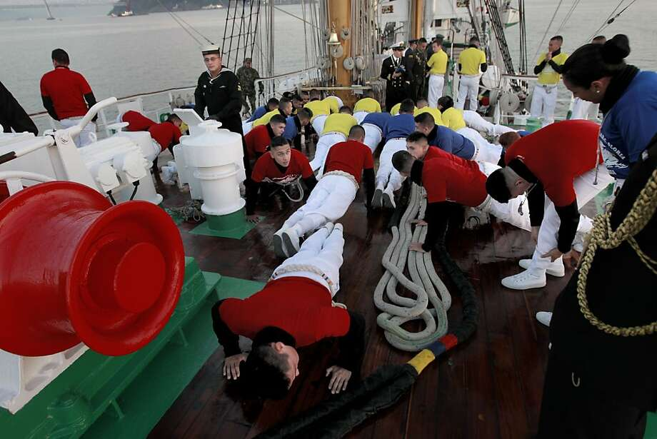"Riggers warm up and stretch as they prepare to climb to the yards above,  aboard  the ""Gloria"" a Colombian navy sailing ship on Friday Oct. 25, 2013, while the vessel makes it's way to pier 17 along the Embarcadero in San Francisco, Calif. Photo: Michael Macor, The Chronicle"