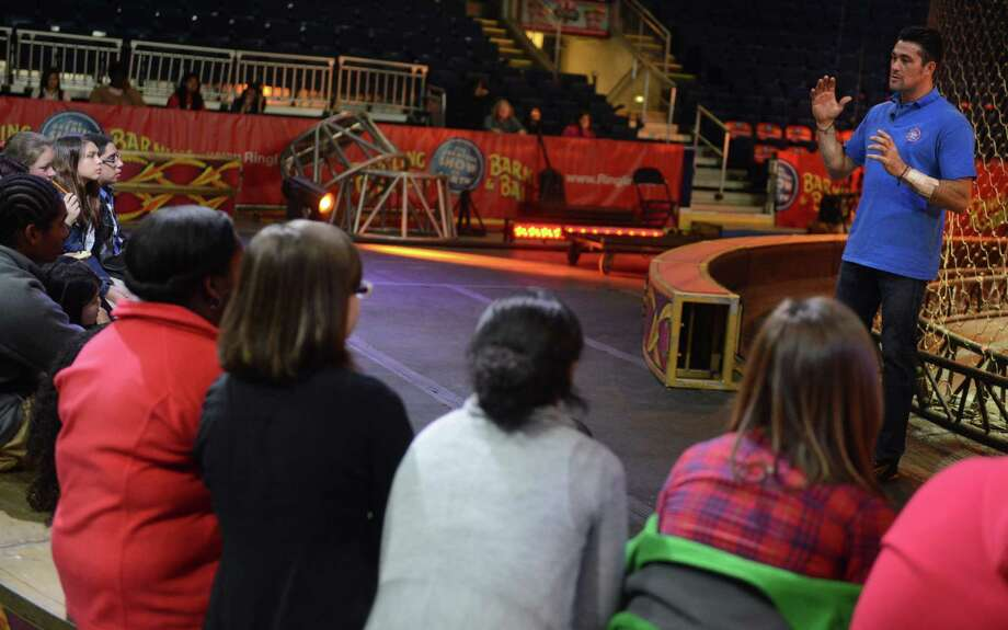 "Big cat trainer and presenter Alexander Lacey gives a special seminar on ""Working with Big Cats"" to students from Trumbull Agri-Science classes and Zoological and Biotechnological Sciences students from the new Fairchild Wheeler Magnet School in Bridgeport Friday, Oct. 25, 2013 at the Webster Bank Arena.  Ringling Bros. and Barnum & BaileyAE Presents DRAGONS will be at the Webster Bank Arena in Bridgeport, Conn through Sunday Oct. 27, 2013. Photo: Autumn Driscoll / Connecticut Post"
