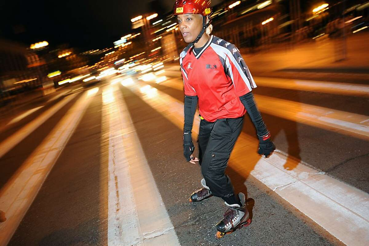 June Solomon crosses Embarcadero as the group heads out for the Friday Night Skate event in San Francisco, California Friday, August 9, 2013.