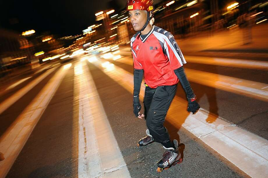 June Solomon crosses Embarcadero as the group heads out for the Friday Night Skate event in San Francisco, California Friday, August 9, 2013. Photo: Michael Short 2013, Special To The Chronicle