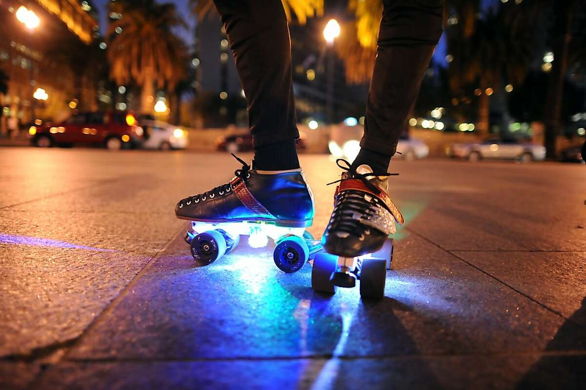 Participants are encouraged to wear protective gear and lights for safety during the Friday Night Skate event in San Francisco, California Friday, August 9, 2013.