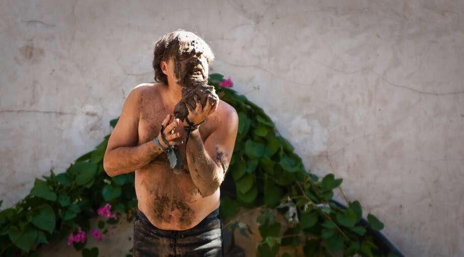 Spanky Nipple Twist, of the Sturdy Beggars, eats mud as a part of his comedy routine at the Mud Pit stage during the Texas Renaissance Festival, Sunday, Oct. 28, 2012,  in Todd Mission. Photo: Nick De La Torre, Houston Chronicle