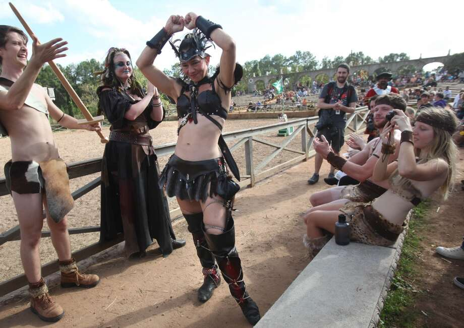 Cassandra Coleman is cheered by the crowd as she is told she is 1st place winner during the Best Dressed Barbarian Contest at the Renaissance Festival on Sunday, Nov. 20, 2011, in Plantersville. Photo: Mayra Beltran, Houston Chronicle