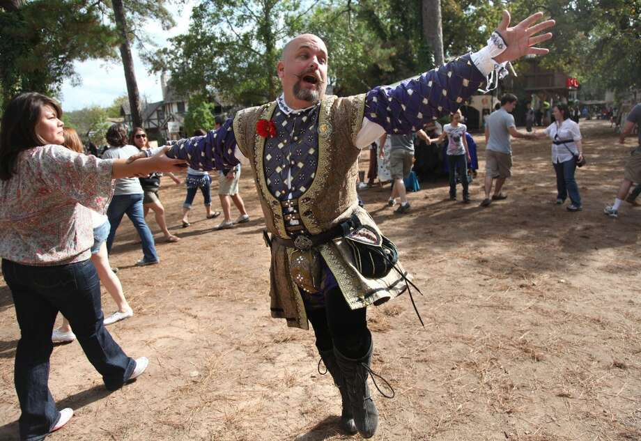 "Carla Travis, 25, dances with ""Lord Norfolk"", better known as Andrew Giles, during the Renaissance Festival on Sunday, Nov. 20, 2011, in Plantersville. Photo: Mayra Beltran, Houston Chronicle"