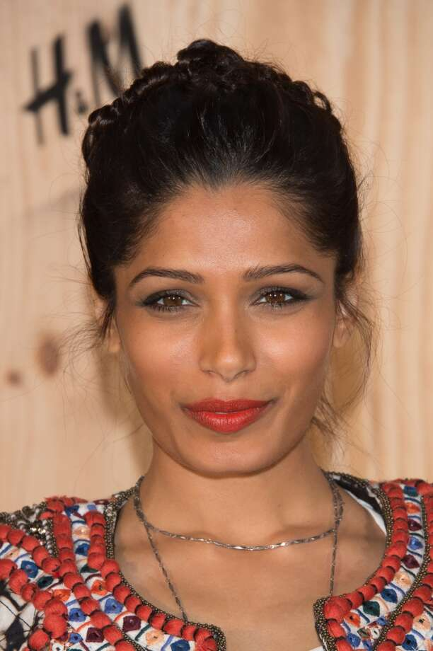 Freida Pinto attends the  'Isabel Marant For H&M' : Photocall At Tennis Club De Paris on October 24, 2013 in Paris, France. Photo: Dominique Charriau, WireImage