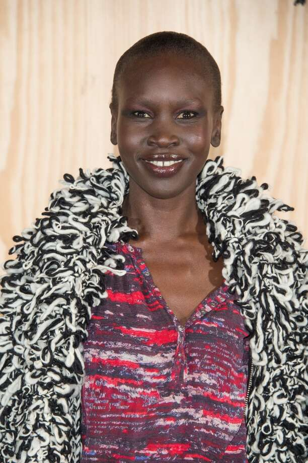 Alek Wek attends the  'Isabel Marant For H&M' : Photocall At Tennis Club De Paris on October 24, 2013 in Paris, France. Photo: Dominique Charriau, WireImage