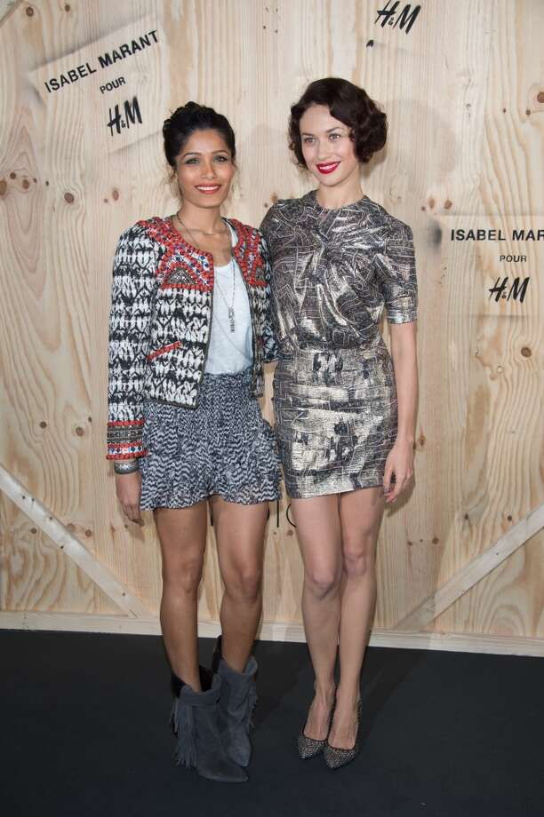 Freida Pinto and Olga Kurylenko attend the  'Isabel Marant For H&M' : Photocall At Tennis Club De Paris on October 24, 2013 in Paris, France. Photo: Dominique Charriau, WireImage