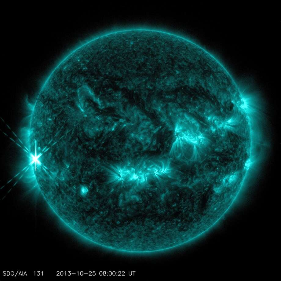 """This is the first of two solar flares on Friday, Oct. 25, 2013. NASA describes the photo this way: """"NASA's Solar Dynamics Observatory captured this image of an X1.7 class flare on Oct. 25, 2013. The image shows light in the 131-angstrom wavelength, which is good for seeing material at the intense temperatures of a solar flare, and which is typically colorized in teal."""" (NASA/SDO photo)"""
