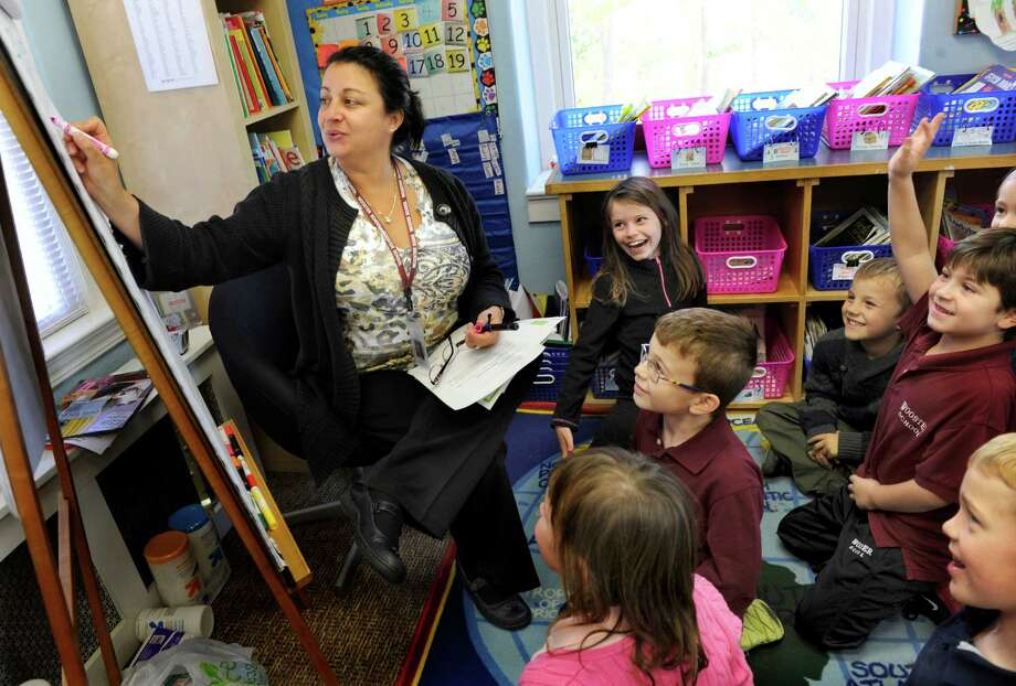 Wooster School teacher Stacey Koenig leads her second-graders through the process of solving a mystery Thursday, Oct. 24, 2013. Wooster School on Miry Brook Road in, Danbury, Conn., is a pre-school through 12, private co-educational school. Photo: Carol Kaliff / The News-Times