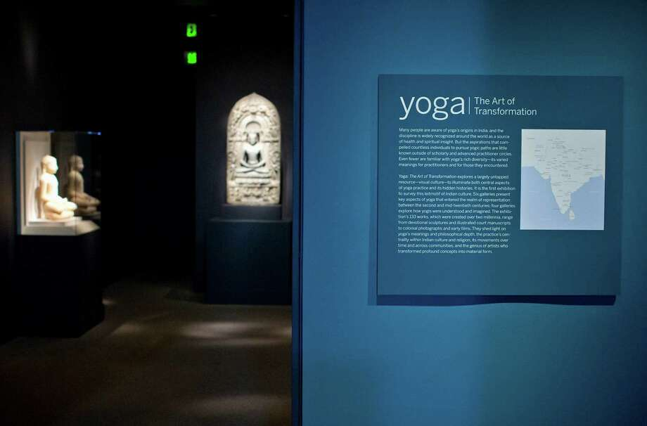 A view during the press preview of Yoga: The Art of Transformation at the Smithsonian's Sackler Gallery in Washington, Tuesday, Oct. 22, 2013. The Smithsonian Institution has organized what curators believe is the first exhibition about the visual history and art of yoga. The exhibition includes Indian sculpture, manuscripts and paintings, as well as posters, illustrations, photographs and films to showcase the history of yoga over 2,000 years. (AP Photo/ Evan Vucci) Photo: Evan Vucci, STF / AP
