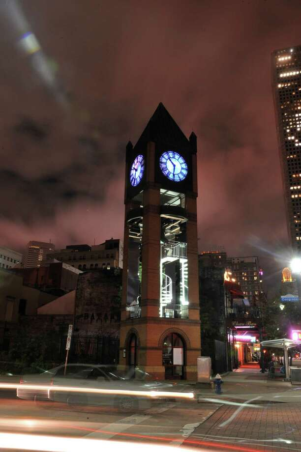 "Jo Ann Fleischhauer's ""What Time Is It?"" art installation transforms the Market Square clock tower. Photo: Jimmy Hemphill"