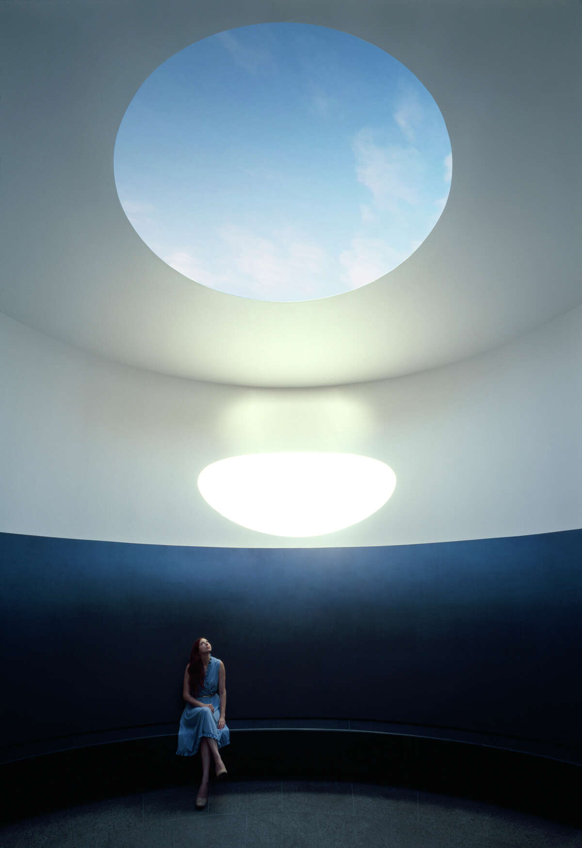 """""""The Color Inside,"""" the new James Turrell skyspace installation atop the Student Activity Center at the University of Texas at Austin, has an elliptical cylinder shape with a built-in bench for 25 people."""