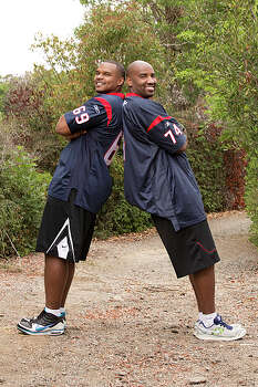 Former Football Teammates Chester Pitts (left) and Ephraim Salaam (right) compete in a sprint around the globe for $1 million dollars on 'The Amazing Race.' Photo: Cliff Lipson, ©2013 CBS Broadcasting, Inc. All Rights Reserved. / ©2013 CBS Broadcasting, Inc. All Rights Reserved.