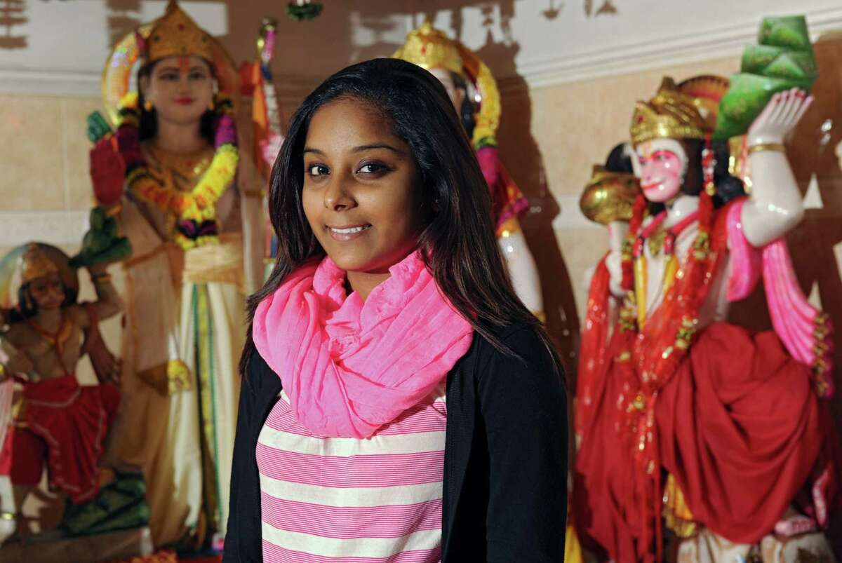 Abashmattie Deodat of Schenectady stands on the Alter at the Schenectady Hindu Temple on Monday, Oct. 21, 2013 in Schenectady, N.Y. Family and friends in her religion will be celebrating Diwali with a festival this weekend. (Lori Van Buren / Times Union)