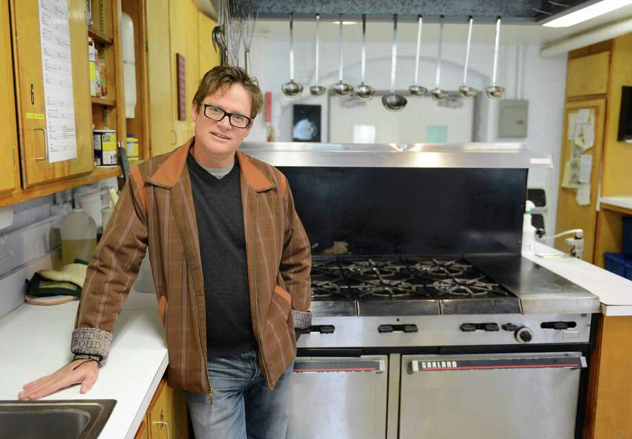 "Sherman musician Don Lowe poses inside the kitchen of Loaves & Fishes food bank in New Milford, Conn. on Friday, Oct. 25, 2013.  Lowe is one of a group of artists and poets participating in a benefit organized by Voices of Poetry that will be held at Loaves and Fishes on Nov. 9. Lowe said he likes to use his music to help others ""because I want to feel like I have a voice in this world."" Photo: Tyler Sizemore / The News-Times"