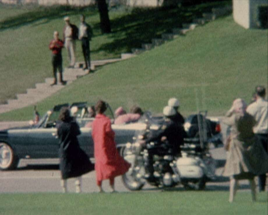 First lady Jacqueline Kennedy cradles her husband President John F. Kennedy seconds after he was fatally shot. This frame grab image was made from a restored version of a film. Photo: Associated Press File Photo