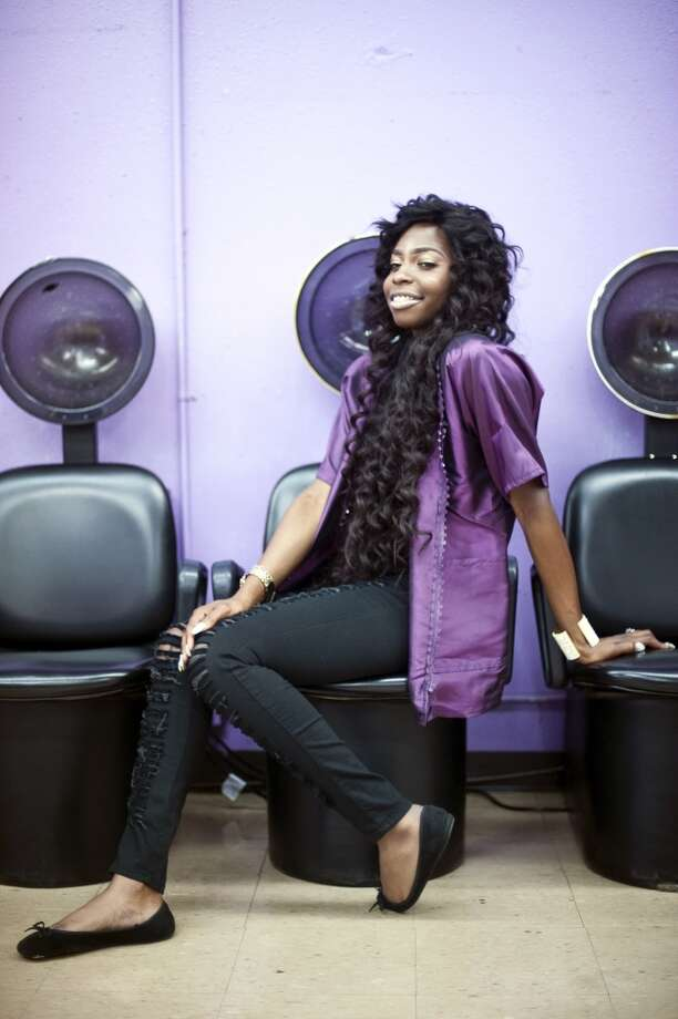 """Mia Ryan, a member of the cast of """"Houston Beauty"""" sits for a portrait at the Franklin Beauty School in Houston. Houston Beauty follows the Franklin Beauty School, the oldest in beauty school in Texas. Photo: Brandon Thibodeaux, Oprah Winfrey Network"""