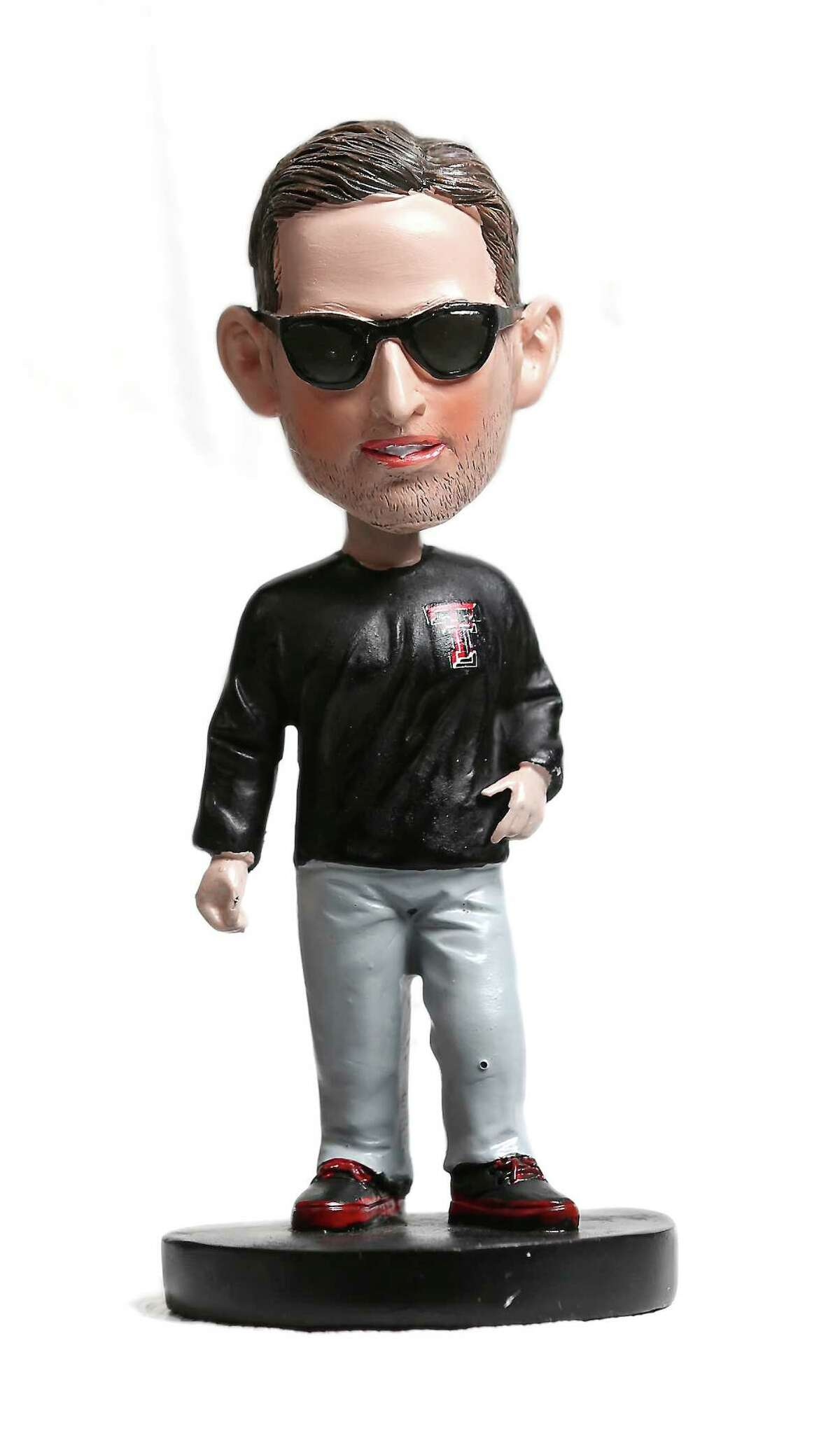 A recently released 2013 bobble-head doll of Texas Tech head coach Kliff Kingsbury is seen in the Express-News studio Oct. 24, 2013. Kingsbury, who's alma mater is Texas Tech, is currently 7-1 as the first-year coach of the Red Raiders.