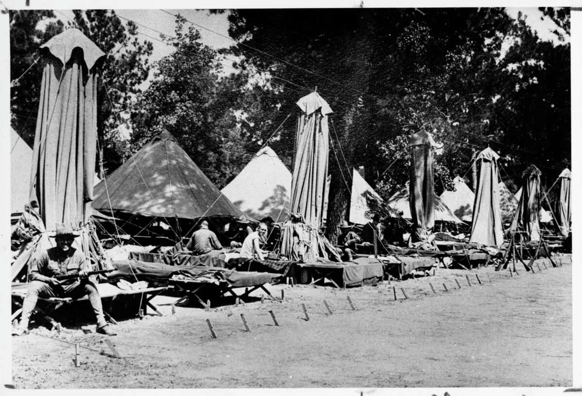 World War I soldiers take a break in the tent city at Camp Logan, which later became Memorial Park.