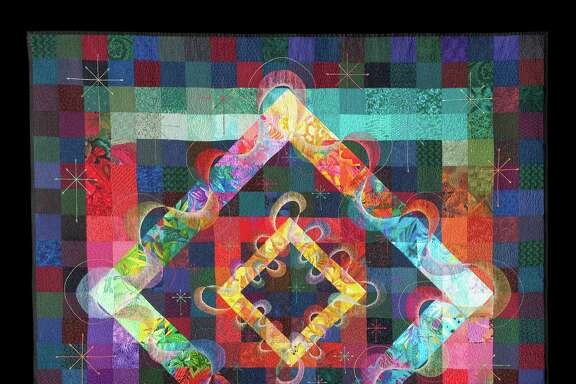 """Joy Ride,"" by Libby Lehman, was named one of the 100 best American quilts of the 20th century. Insured for $50,000, it will be on display at the International Quilt Festival."