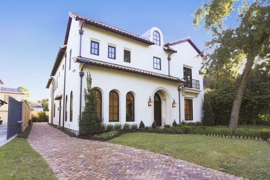 This stunning Spanish Colonial boasts as many as six bedrooms.