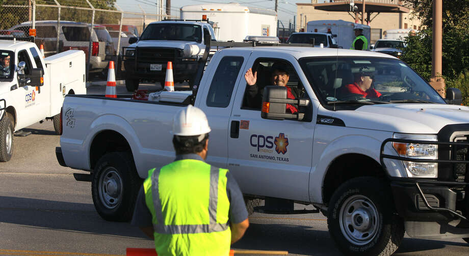 A convoy of CPS Energy trucks leaves the East Side Service Center. The proposed rate increase is merited and CPS should be allowed to continue to excel. Photo: John Davenport / San Antonio Express-News