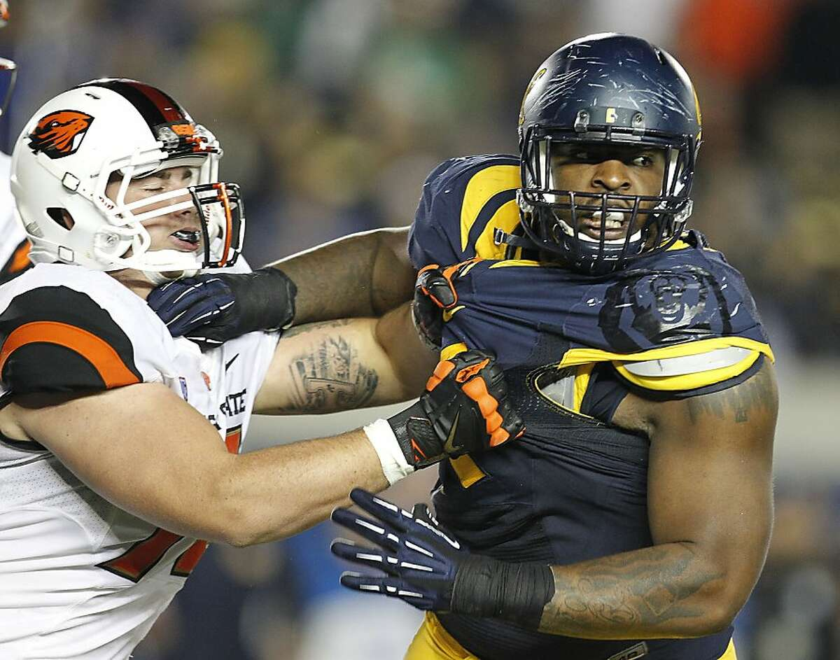 California defensive lineman Deandre Coleman (91) rushes the quarterback against Oregon State offensive linesman Sean Harlow (78) during the second half of an NCAA college football game in Berkeley, Calif., Saturday, Oct. 19, 2013. (AP Photo/Tony Avelar)