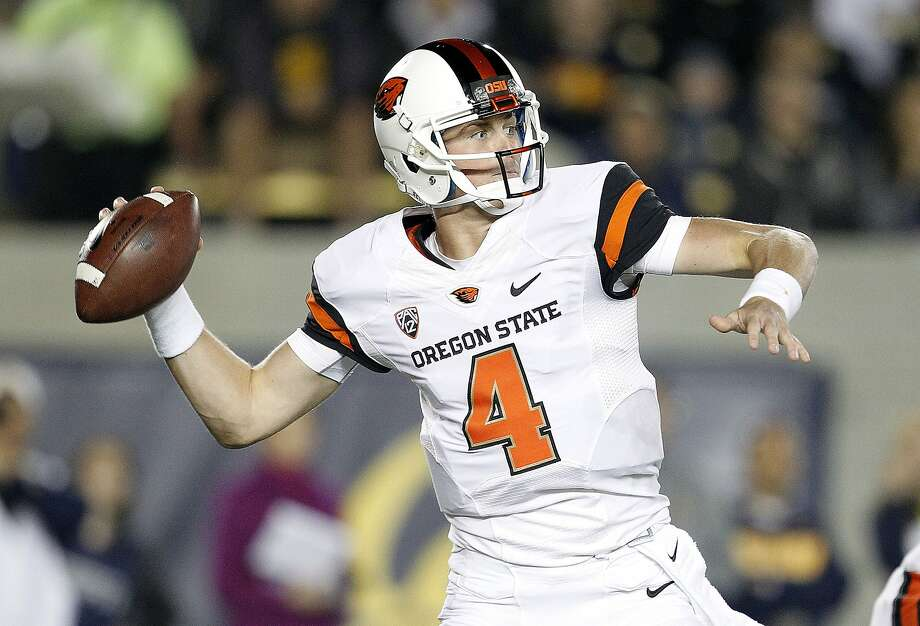 Oregon State quarterback Sean Mannion (4) throws a pass against California during the first quarter of an NCAA college football game in Berkeley, Calif., Saturday, Oct. 19, 2013. (AP Photo/Tony Avelar) Photo: Tony Avelar, Associated Press