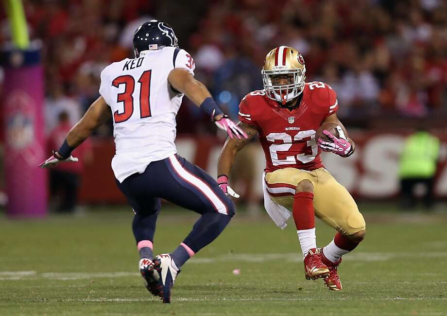 SAN FRANCISCO, CA - OCTOBER 06:  Running back  LaMichael James #23 of the San Francisco 49ers is pursued by free safety Shiloh Keo #31 of the Houston Texans in the second half at Candlestick Park on October 6, 2013 in San Francisco, California. The 49ers defeated the Texans 34-3.  (Photo by Jeff Gross/Getty Images) Photo: Jeff Gross, Getty Images