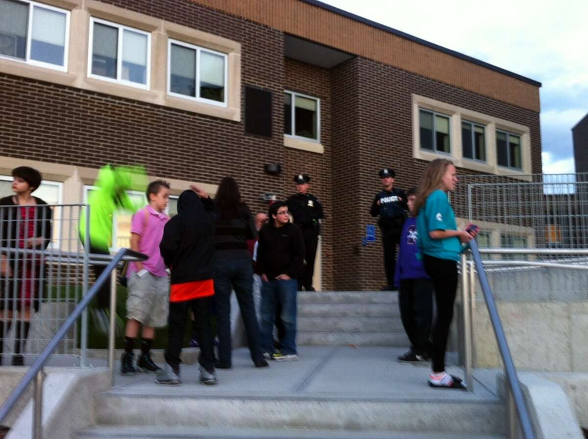 Police watch as students gather at Troy Middle School for a dance on Friday, Oct. 25, 2013. (Kenneth C. Crowe II/Times Union)
