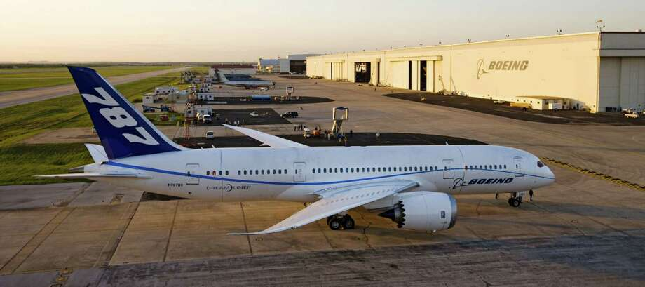 A Boeing 787 Dreamliner made its first landing in San Antonio several years ago. Boeing recently announced that it was laying off 50 Port San Antonio employees, blaming a lapse in 787 Dreamliner work. Photo: Imaging Services STL, The Boeing