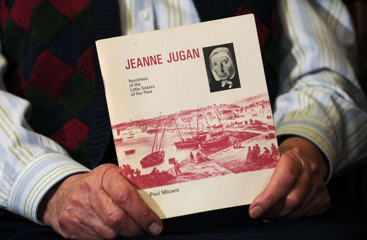 In this 2009 photo, Loretta Charbeneau holds a book about Jeanne Jugan after Jugan, foundress of the Little Sisters of the poor, was cleared for sainthood.. (Lori Van Buren / Times Union archive)