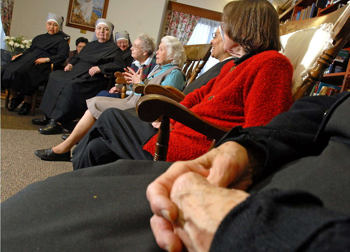 In this 2009 photo, members of the Little Sisters of the Poor are shown at Our Lady of Hope Residence in Latham, NY, talking about the news that their order's foundress, Jeanne Jugan, was cleared for sainthood. (Lori Van Buren / Times Union archive)