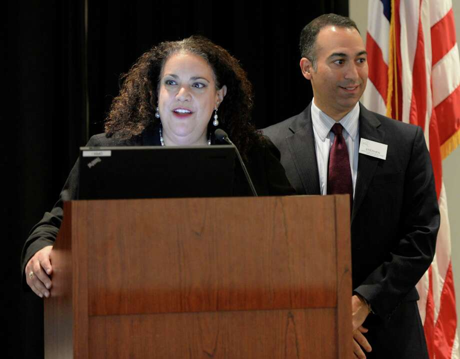 Donna Frescatore, assistant deputy secretary for Health and deputy director for Health Care Redesign in the Cuomo administration, speaks to members of the Nurse Practitioner Association of NYS  Friday morning, Oct. 25, 2013, at the Saratoga City Center in Saratoga Springs, N.Y. With Frescatore is Stephen Ferrara, president of the Nurse Practitioner Association of NYS.    (Skip Dickstein / Times Union) Photo: Skip Dickstein / 00024339A