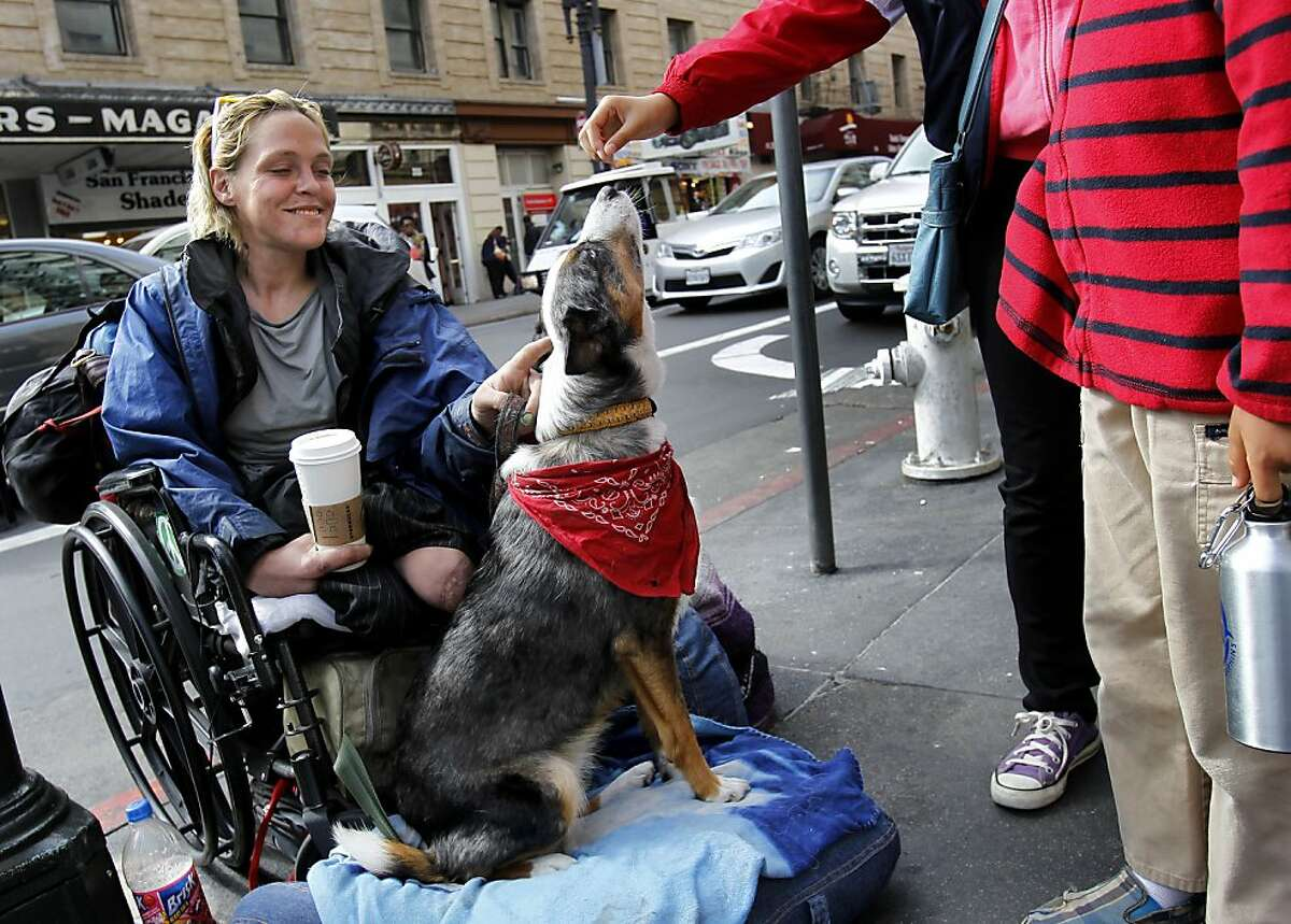 Bambie, a panhandler who has no legs, let some children feed her dog as she sat in front of the Starbucks on Powell Street Tuesday October 22, 2013 in San Francisco, Calif. She participated in the survey. The Union Square Business Improvement district surveyed 150 panhandlers in the area, getting a wealth of information about who's begging and who's giving.