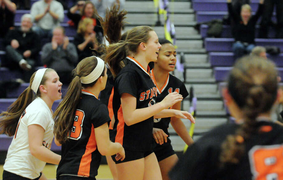 Stamford's Cali Schenkel celebrates with teammates after their win as Westhill High School hosts Stamford High in a girls volleyball game at Westhill in Stamford, Conn., Oct. 25, 2013. Stamford won 3-0. Photo: Keelin Daly / Stamford Advocate Freelance