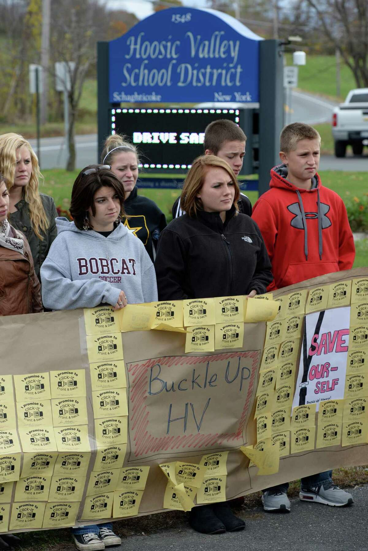 Students from Hoosic Valley High School display a poster which created to promote safe driving Friday morning, Oct. 25, 2013, during a press briefing held by Troop G Major Steven James at the Hoosic Valley High School in Schaghticoke, N.Y. (Skip Dickstein / Times Union)